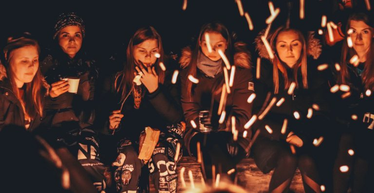 Girls around a campfire